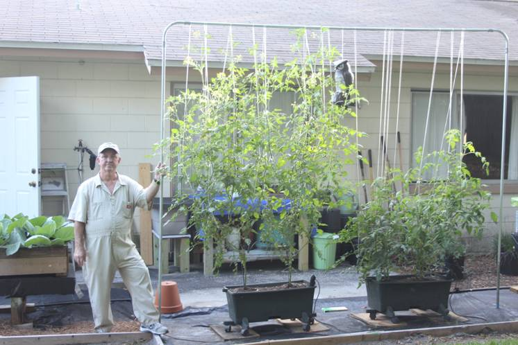 Lloyd Babb with 7 week old plants grown in Mother Nature's Compost