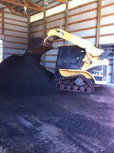 working Mother Nature's compost in warehouse